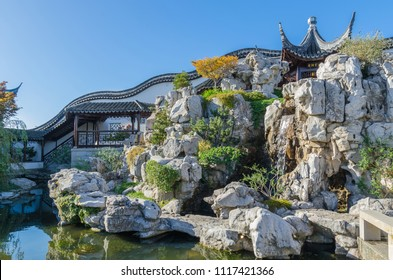 """Dunedin,New Zealand - May 3,2016 : Pai Lau Gateway of the The Dunedin Chinese Garden in New Zealand, this elaborate archway represents """"the face"""" of the garden."""