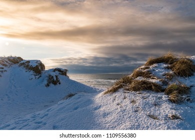 Dunes covered in snow sunset