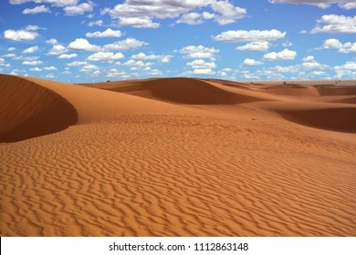 Dunes made up of red clay sand within the Mauritania Sahara Desert
