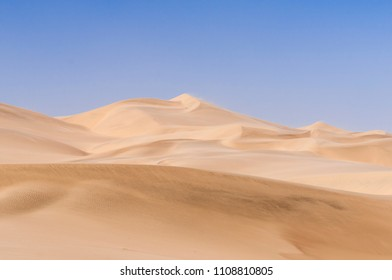 Dunes in Sandstorm at Skeleton Coast, Namib Desert, Namibia, Africa. / Dunes on the Skeleton Coast