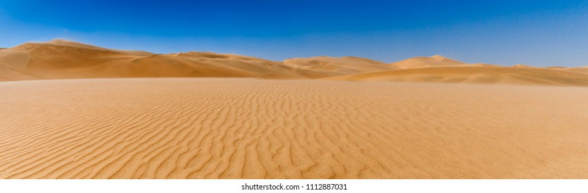 Dunes in Sandstorm at Skeleton Coast, Namib Desert, Namibia, Africa. / Dunes on the Skeleton Coast
