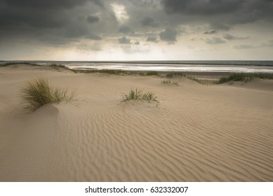 Dunes under a cloudy dramatic sky