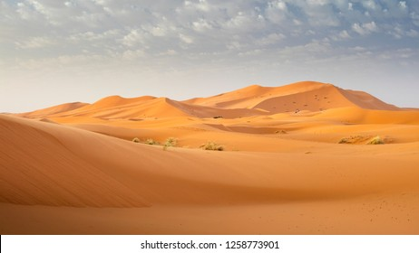 dunes under light clouds  in desert in Morocco