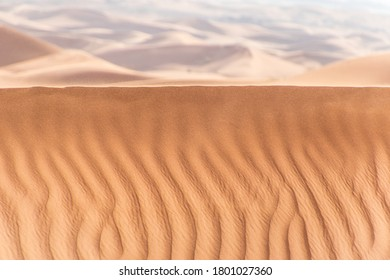 Dunes and wind. Sand is flowing. Dunes are moving.
