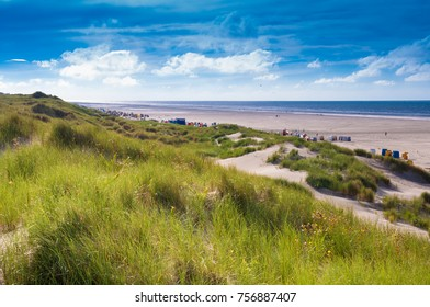 In the dunes at a windy and sunny day on the island of Juist, Germany