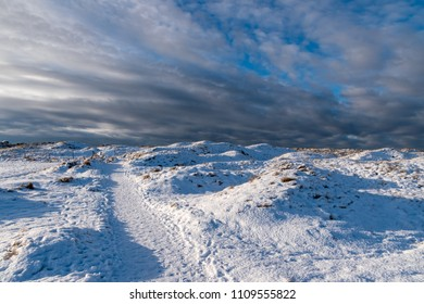 Dunes at wintertime with snow