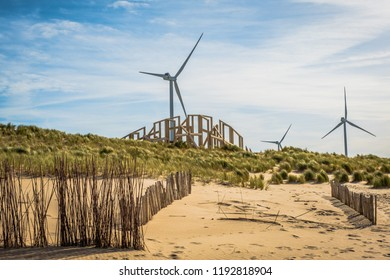 Dunes in Zandwacht in The Netherlands, wind turbines and sand.