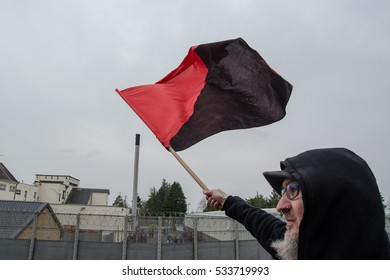 DUNGAVEL DETENTION CENTRE, STRATHAVEN, SCOTLAND, 7TH MAY 2016 - Bearded activist flies anarchist flag over detention centre