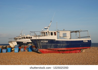 DUNGENESS, ENGLAND - JANUARY 27, 2014: Fishing boats on the shingle beach at Dungeness in Kent. With no harbour, the boats are launched directly from the beach.