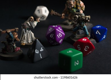 Dungeons and Dragons dice and hand painted lead figures produced by Games Workshop in 1983 as accessories to the game created by by Gary Gygax and Dave Arneson in 1974. Wrexham UK - March 21 2017