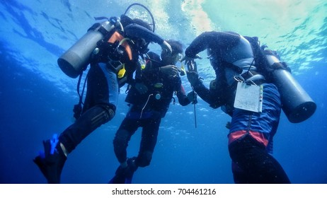 DUNGUN, MALAYSIA - AUGUST 28, 2017 : A group of diver doing safty stop before they come out to surface.