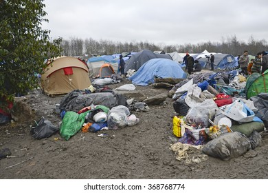 Dunkerque, France-23 January 2016: Refugee camp Grande-Synthe in France is a muddy camp with a lot of dirty waste. People are cold and hungry.