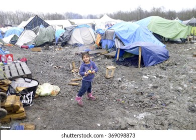 Dunkerque, France-24 January 2016: Inidentified girl in the refugee camp Grande-Synthe in France is a muddy camp with a lot of dirty waste.
