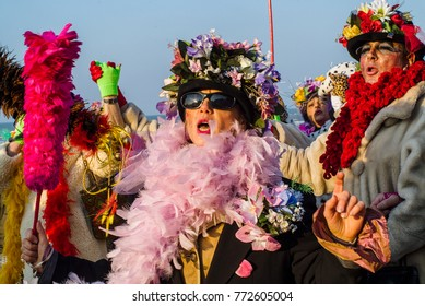 DUNKIRK, France – february 23, 2004 : Dunkirk Carnival, Many men disguise themselves as women and for that they adopt wigs, fishnet skirts, jewelery, fake eyelashes, makeup, flower hats.