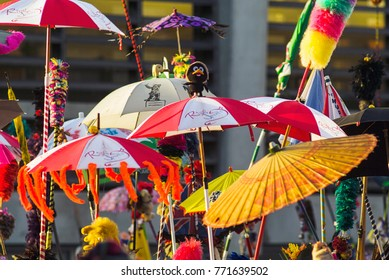 "DUNKIRK, France – february 25, 2004 : Dunkirk Carnival, The multicolored umbrella, called ""berguenaere"" also has a central place in the carnival"