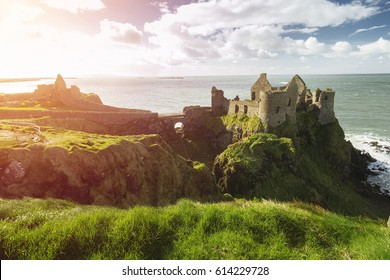 Dunluce Castle, Antrim, Northern Ireland during sunny day with semi cloudy sky