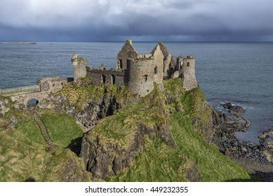 Dunluce Castle, Northern Ireland, at the edge of a cliff