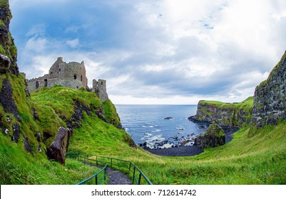 Dunluce castle in Northern Ireland, United Kingdom. Causeway coastal driving route on the Emerald Island.
