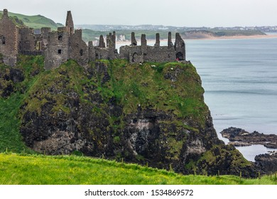 Dunluce Castle - the ruins of an early 13th century medieval castle in County Antrim, Northern Ireland.