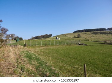 The Dunnichen Reserve reservoir just outside the Village within the hilly farmland full of sheep on a Bright Spring Day, Angus, Scotland.