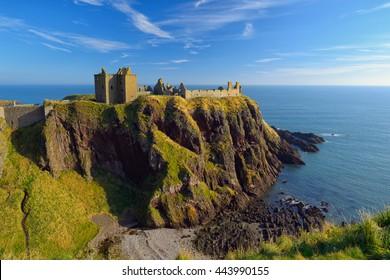 Dunnottar Castle with blue sky background in Aberdeen, Scotland.