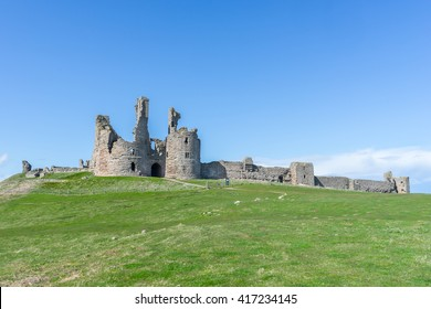 Dunstanburgh Castle on the Northumbrian coast in England