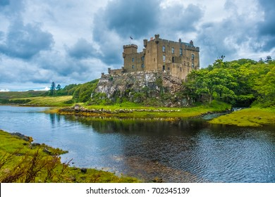 Dunvegan Castle on the Isle of Skye, Highlands of of Scotland. Seat of the MacLeod Clan. Built on an elevated rock overlooking an inlet on the eastern shore of the sea Loch of Dunvegan.