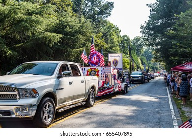 DUNWOODY, GEORGIA - July 4, 2016: Participants and spectators in the annual Dunwoody, Georgia 4th of July parade which attracts over 2,500 participants and 32,000 spectators