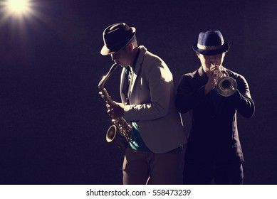Duo musician in dark with lens flare effect