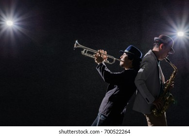 duo musician,saxophone player with trumpet player in dark