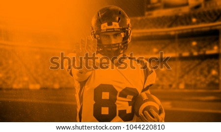 duo toned american football player in  arena at night with stadium lights