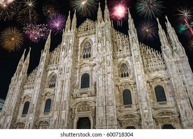 Duomo cathedral with fireworks - celebration of New Year in Milan, Italy