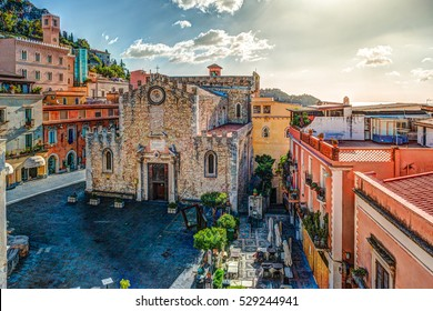 The Duomo in most popular sicilian resort Taormina. Aerial view. Townscape of Taormina with cathedral, square and the hill with other buildings.
