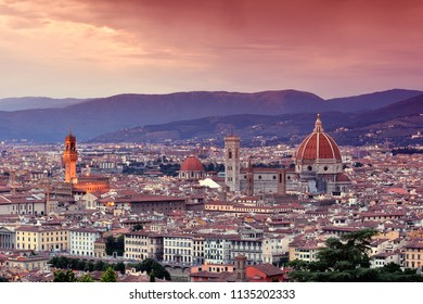 Duomo Santa Maria Del Fiore and tower of Palazzo Vecchio at sunset  in Florence, Tuscany, Italy