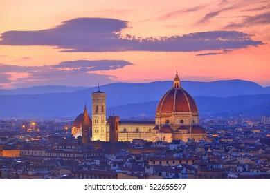 Duomo Santa Maria Del Fiore under the orange sky at dusk, Florence, Tuscany, Italy