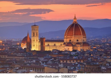 Duomo Santa Maria Del Fiore under the orange sky at dusk, Florence, Tuscany, Italy