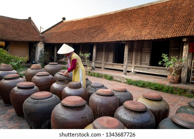 Duong Lam ancient village, Son Tay district, Hanoi, Vietnam - January 3, 2019: The jars of Tuong in ancient house yard, a kind of fermented bean paste made from soybean and commonly used in Vietnamese