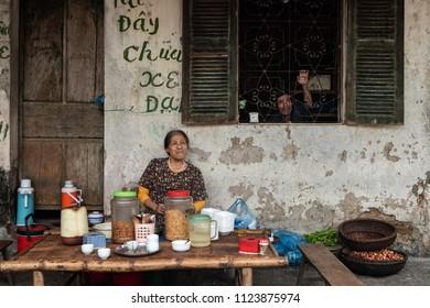 Duong Lam, Ha Noi, Vietnam-April 18, 2018: Vietnamese woman vendors in the street market of the ancient city Duong lam.