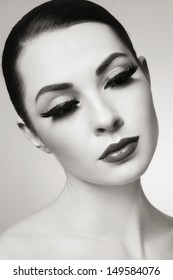 Duotone portrait of young beautiful woman with fake eyelashes
