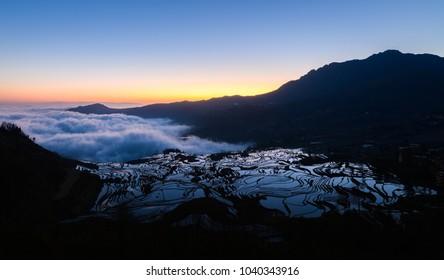 Duoyishu rice terrace at sunrise, Yuangyang, Yunnan, China
