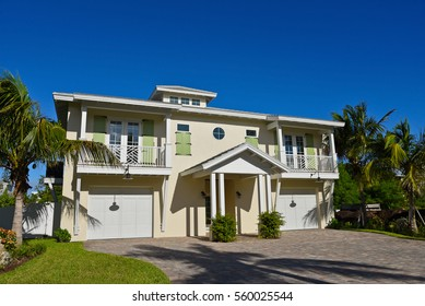 Duplex House with separate decks and garage for each unit and beautiful landscaping.