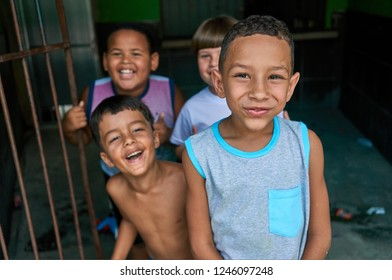Duque de Caxias, Rio de Janeiro, Brazil - December 10, 2018:  Funny Portrait of Slum Kids Together Beautiful Moment Facing Camera Simplicity