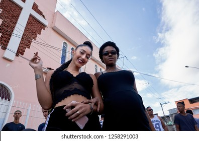 Duque de Caxias, RJ, Brazil, Dec, 2018: Two Pretty Young Women in Black Smoking a Joint in Front of Church Transgression