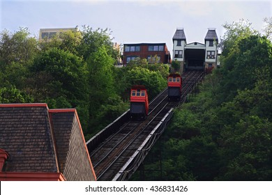 Duquesne Incline in Pittsburgh - recreational, double cabin Incline small train (railroad) system moved from the weight of the cabins seen is railroad, cabins upper station and roof of lower station