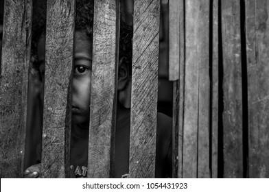Duran Ecuador may/25/2013  poor kid hiding behind a wooden door
