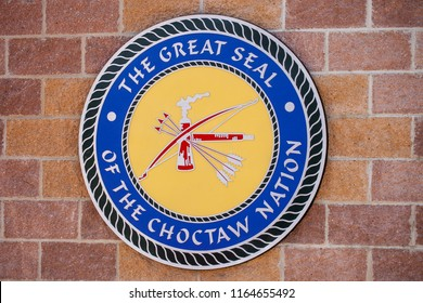 DURANT, OKLAHOMA - JULY 24, 2018 -The great seal of the Chocktaw Nation mounted on a brick wall