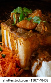 A Durban Bunny Chow - or a quarter mutton bunny - served with sambals. This is an iconic Durban meal consisting of a section of a loaf of bread hollowed out and filled with mutton curry and gravy.