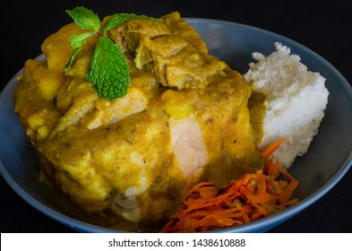 Durban cuisine: A Durban bunny chow, or quarter lamb bunny, served with a sprig of mint and grated carrot sambals