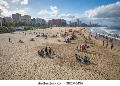 Durban, South Africa - 16 JANUARY 2015, A beautiful view of the beach where people are playing with the waves