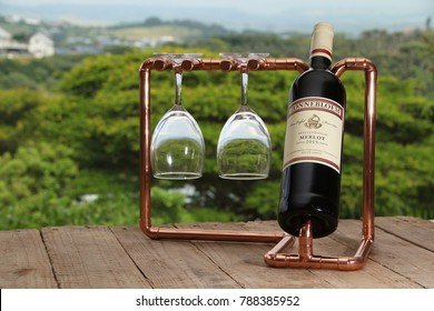 DURBAN, SOUTH AFRICA - 20 MAY 2017: A bottle of La Motte wine on a copper stand. South Africa produces around 10 million hL a year, putting the country in the top 10 global wine producers. Editorial.